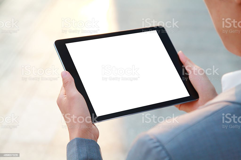 Business people hand holding blank screen digital tablet stock photo