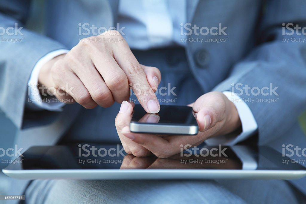 Business people hand holding smart phone and digital tablet stock photo