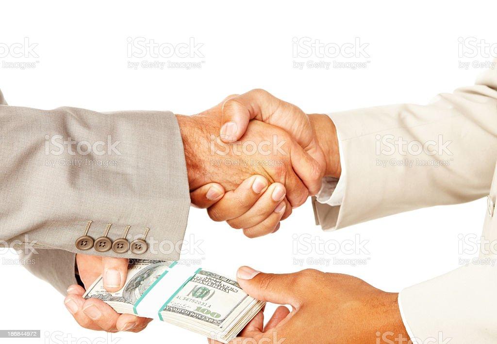 Business people handshake exchanging money royalty-free stock photo