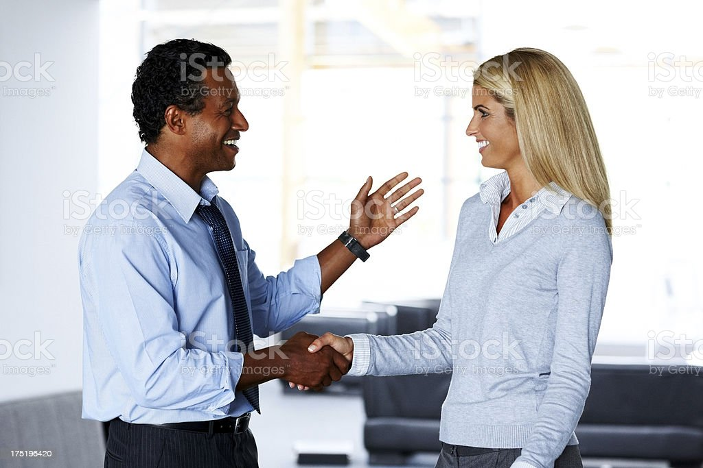 Business people handshakes at the workplace stock photo