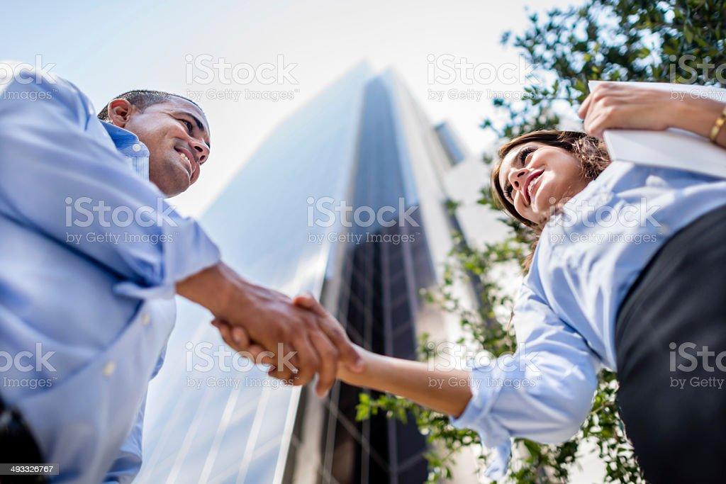 Business people handshaking stock photo