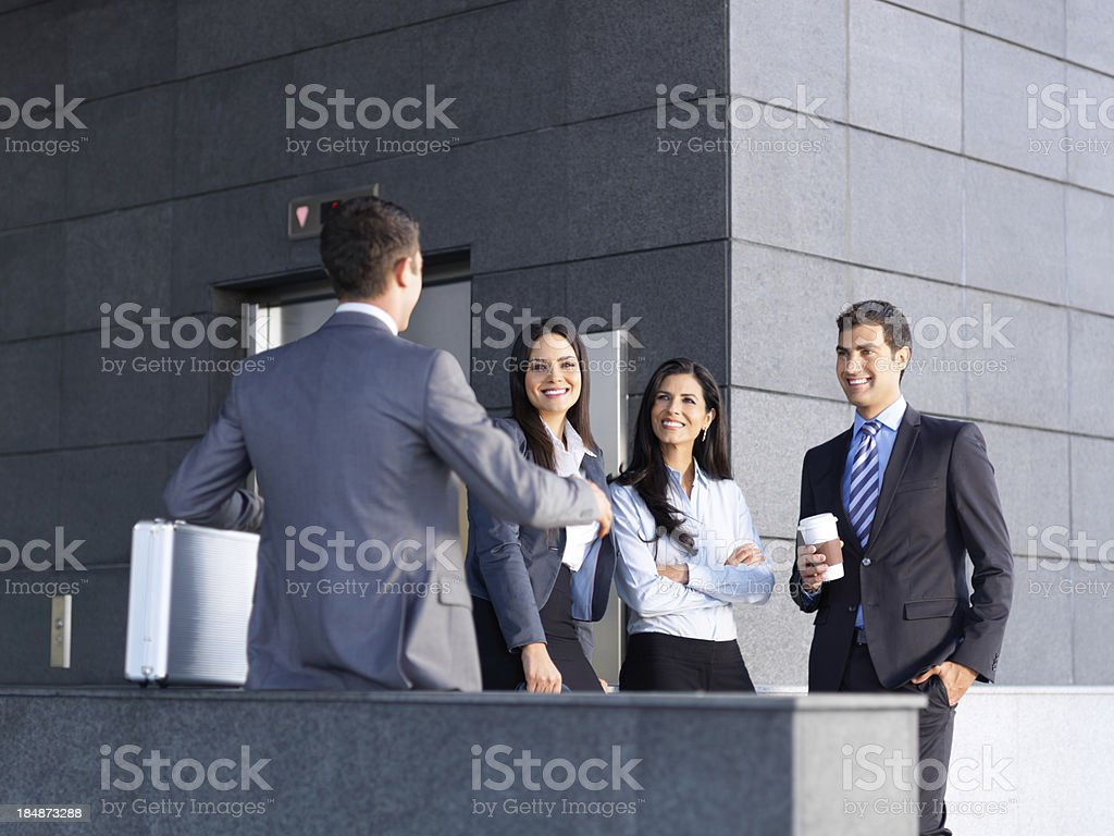 Business people hanging out outside office royalty-free stock photo