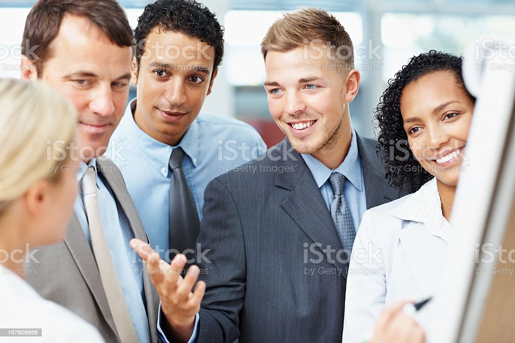 Business people having a discussion at presentation royalty-free stock photo