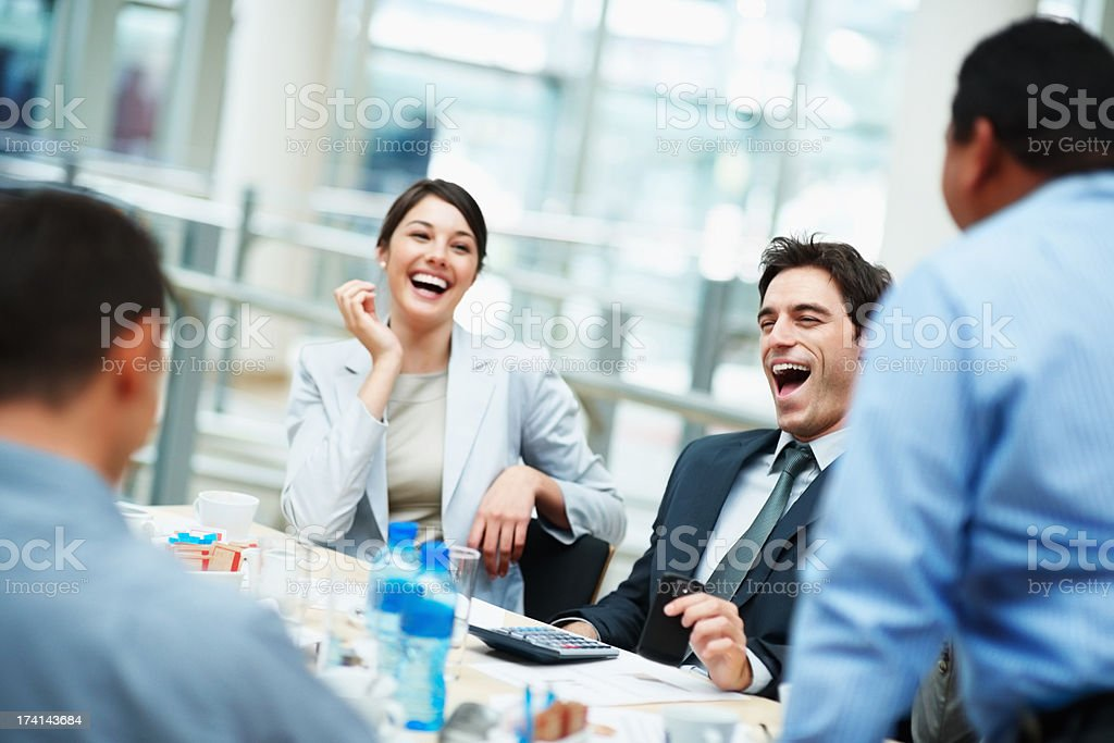 Business people having a good laugh during the meeting stock photo