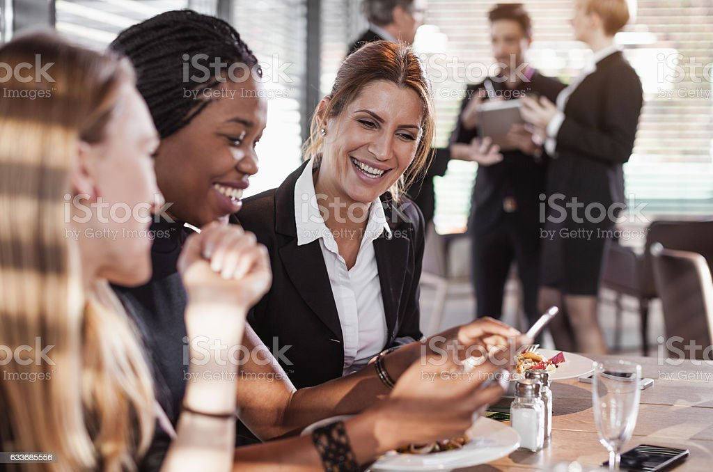 Business People Having a Meal at a Cafe Restaurant stock photo