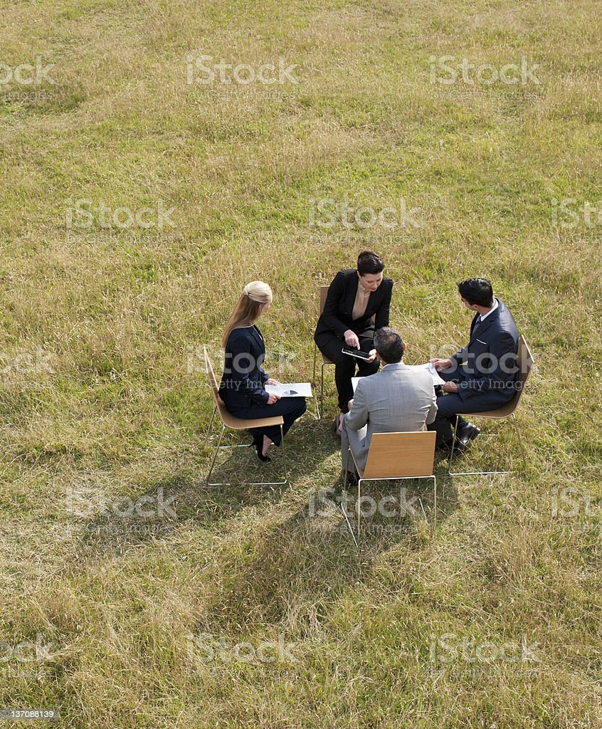 Business people having a meeting outdoors royalty-free stock photo