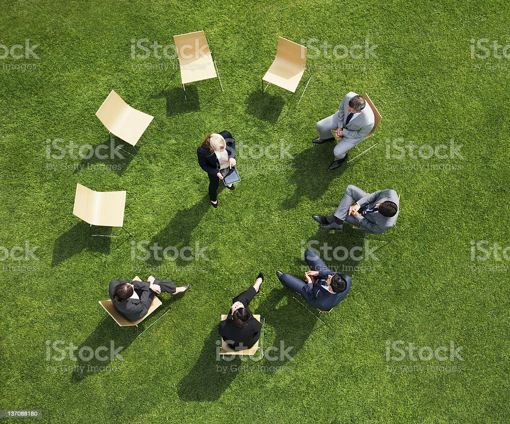 Business people having a meeting outdoors stock photo