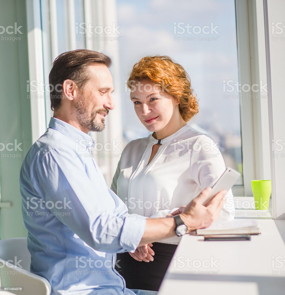 Business people having break during work in office interior stock photo