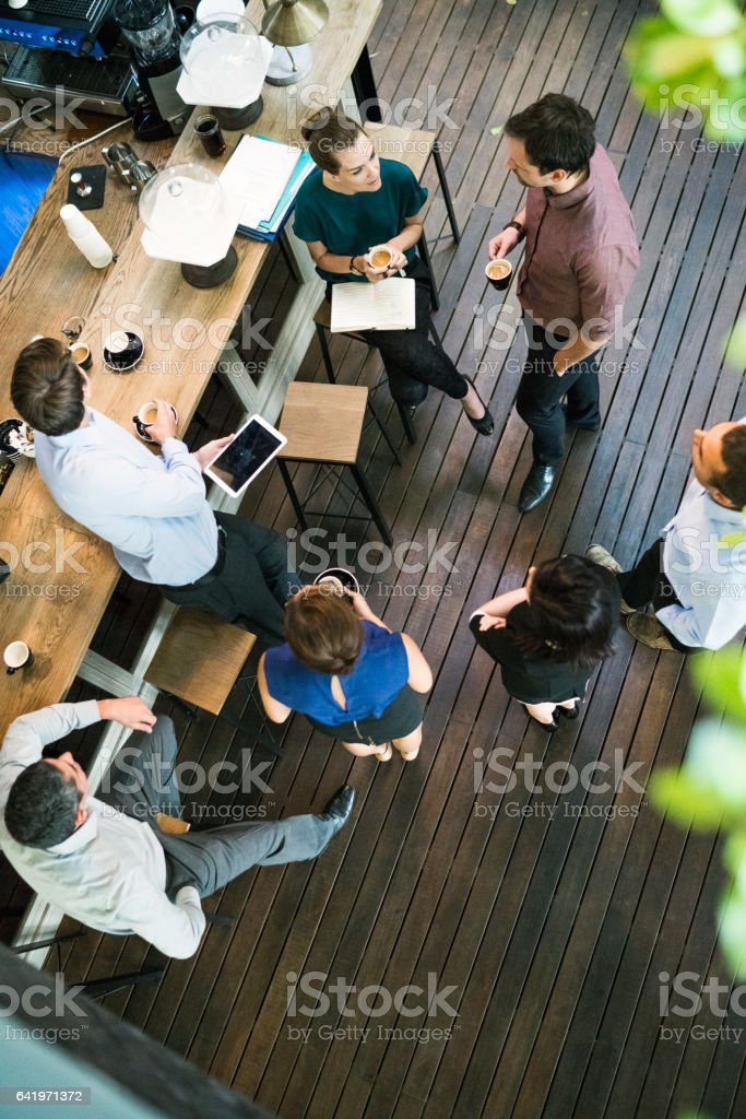Business people having coffee in office cafe stock photo