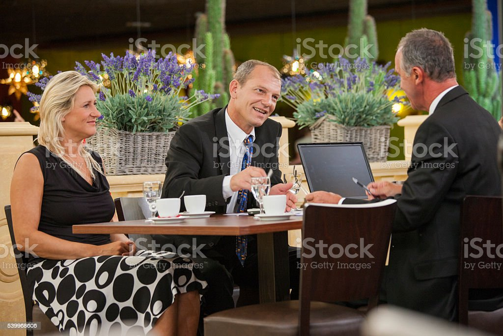 Business people having diner and working in restaurant stock photo