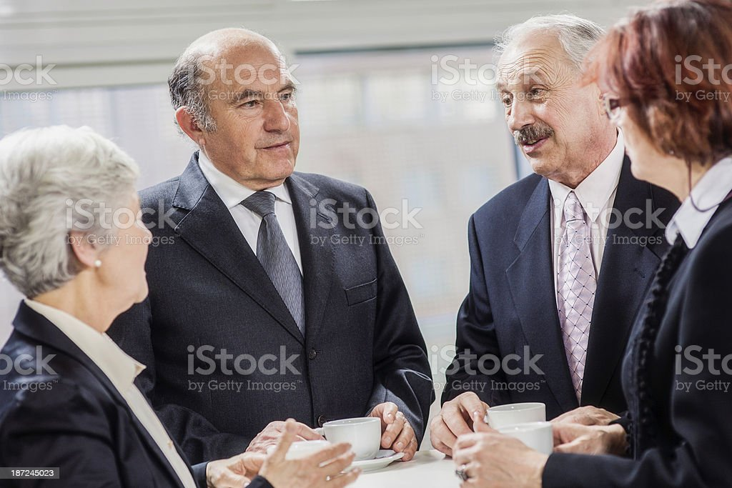Business People Having Discussion During Coffee Break royalty-free stock photo