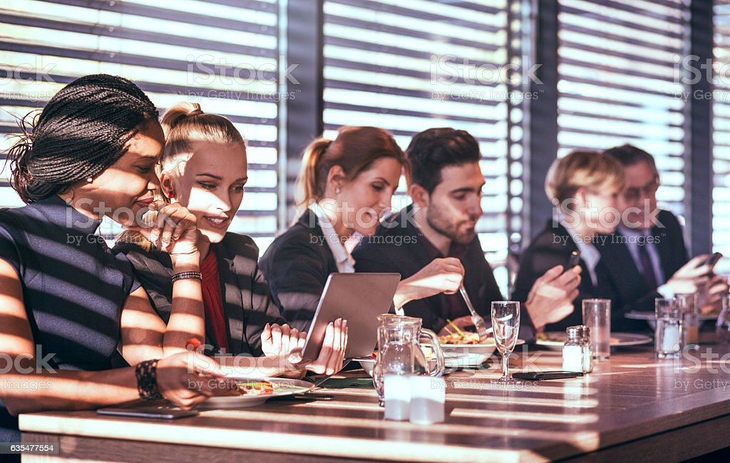 Business people having lunch stock photo