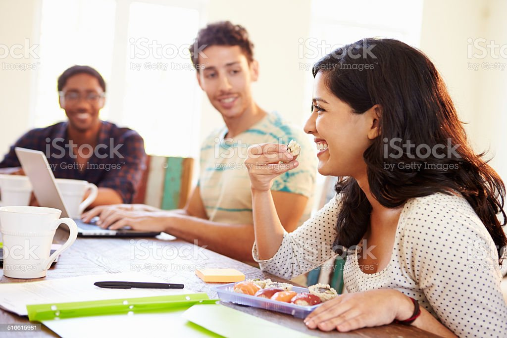 Business People Having Meeting And Eating Sushi stock photo