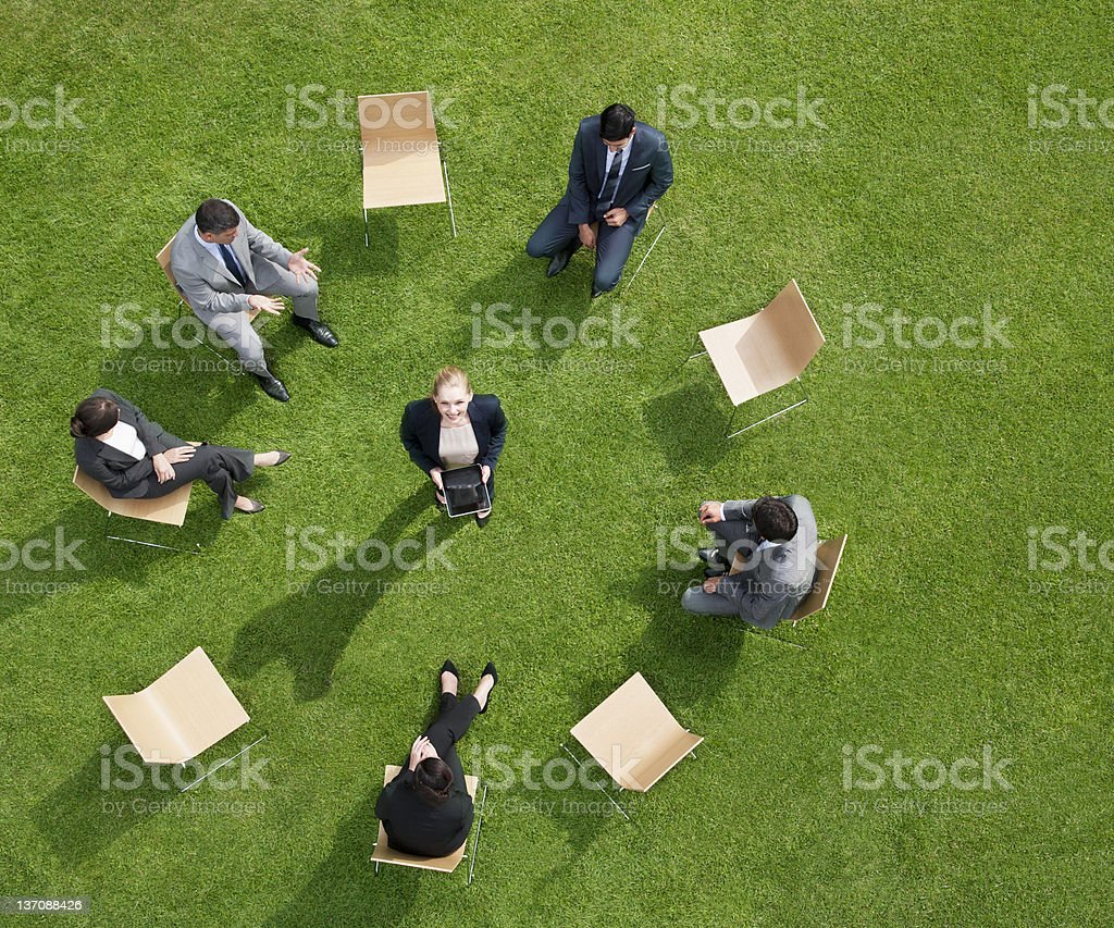Business people having meeting outdoors royalty-free stock photo