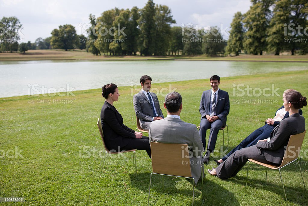 Business people having meeting outdoors stock photo