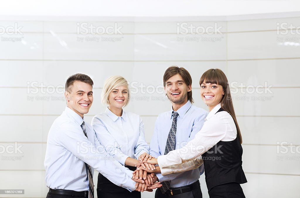 business people hold hands together meeting at office royalty-free stock photo