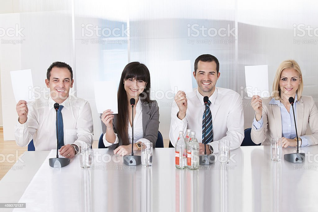 Business people holding a paper in conference stock photo