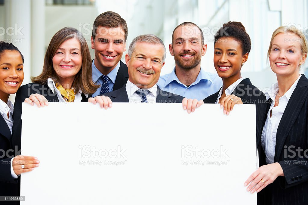 Business people holding a placard royalty-free stock photo