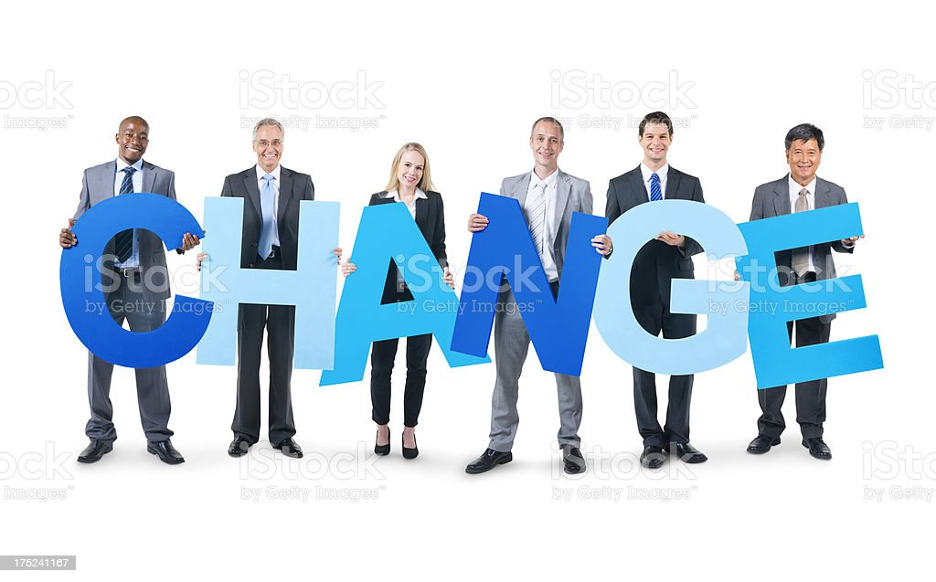 Business people holding big blue letters that spell change stock photo