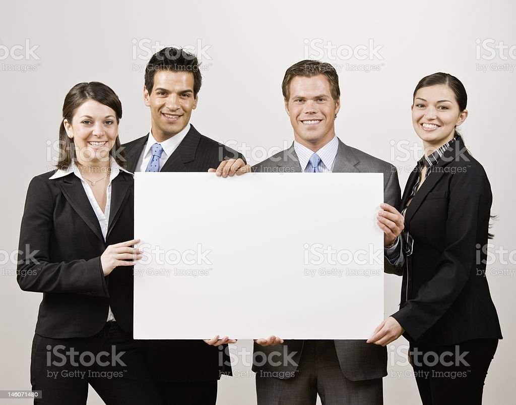 Business people holding blank poster board royalty-free stock photo