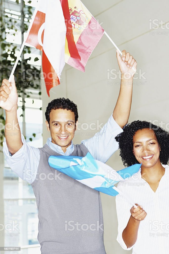 Business people holding flags of different countries stock photo