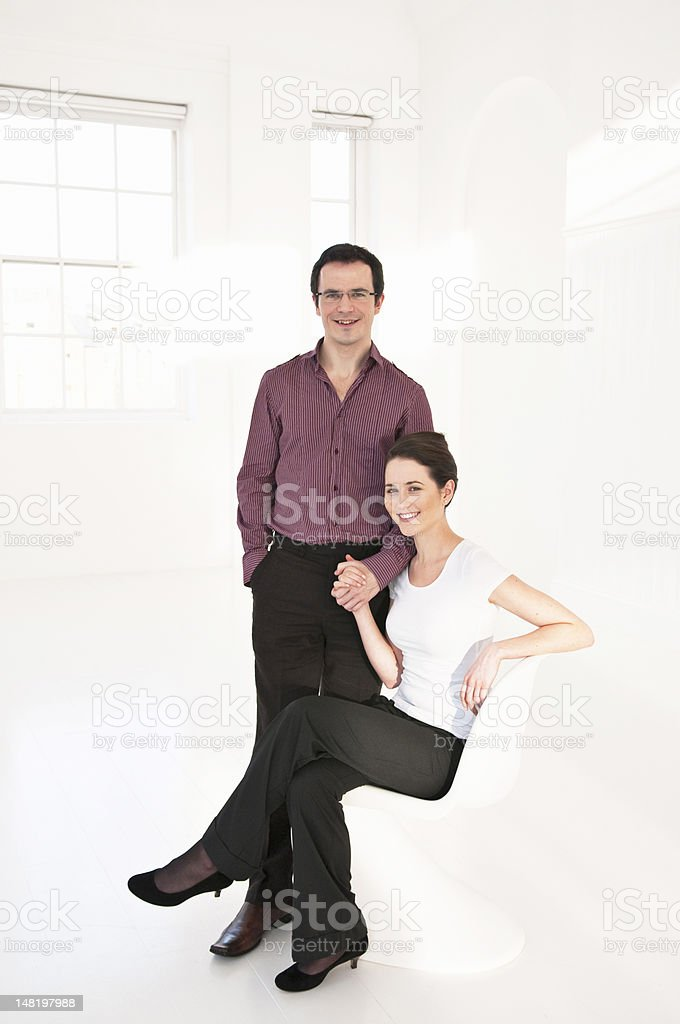 Business people holding hands in lobby royalty-free stock photo