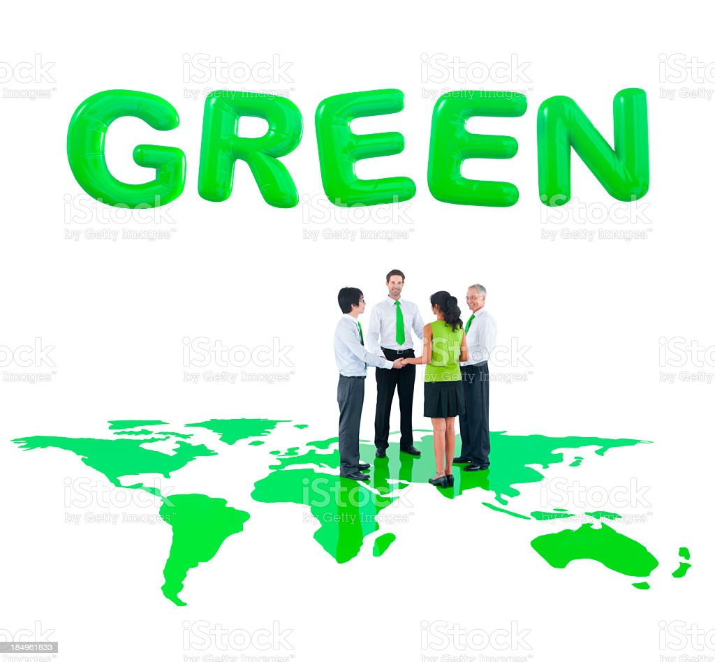 Business people holding hands on green map royalty-free stock photo