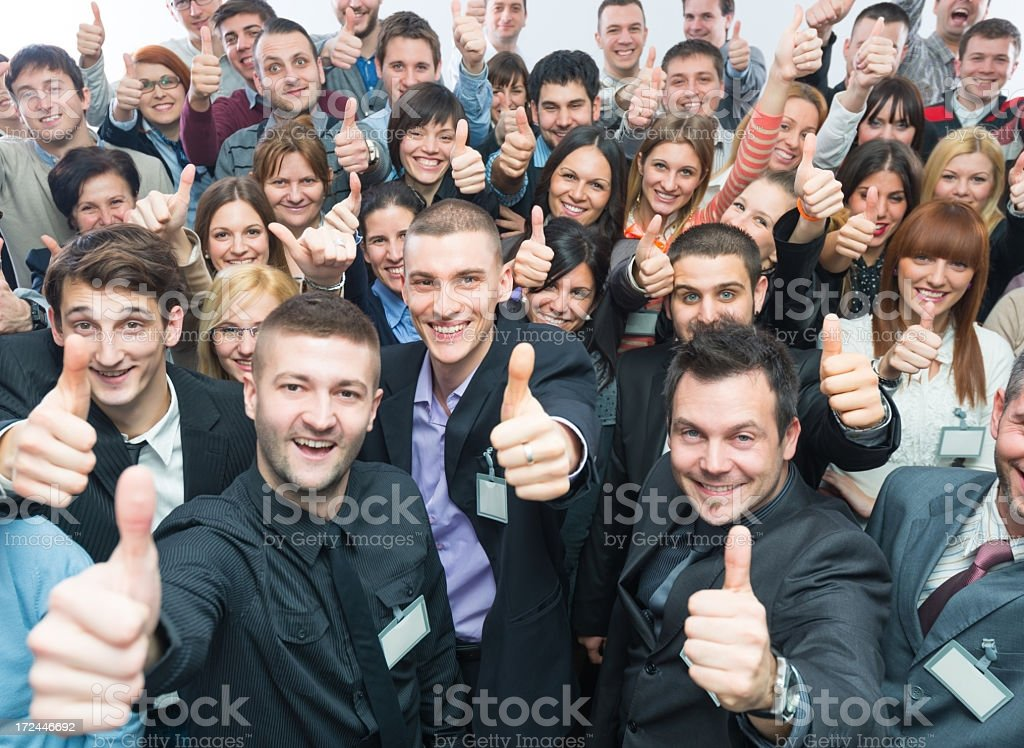 Business people holding their thumbs up. royalty-free stock photo