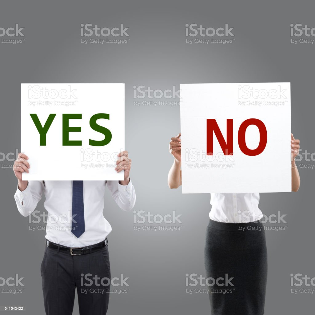 Business people holding yes and no placards stock photo