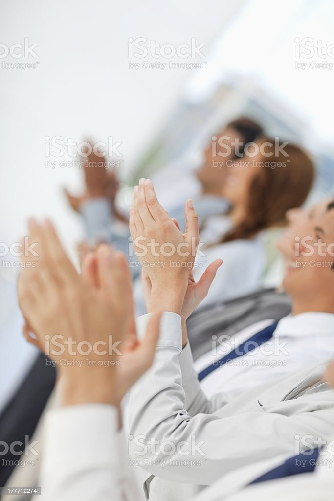 Business people in a line applauding royalty-free stock photo