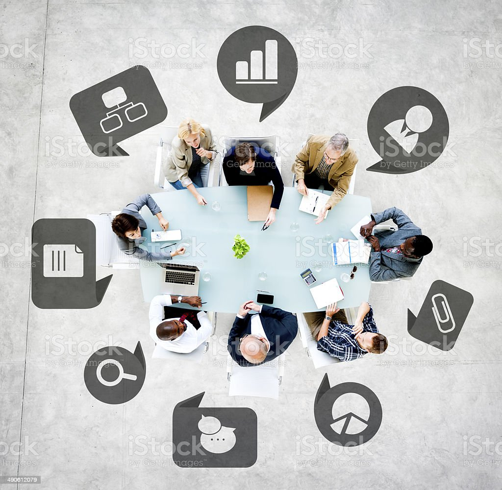 Business People in a Meeting with Business Symbols stock photo