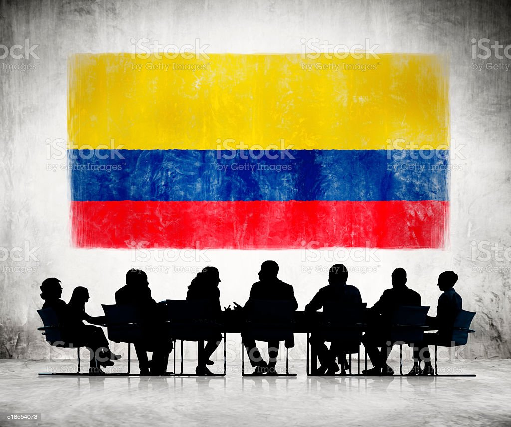 Business People in a Meeting with Colombian Flag stock photo