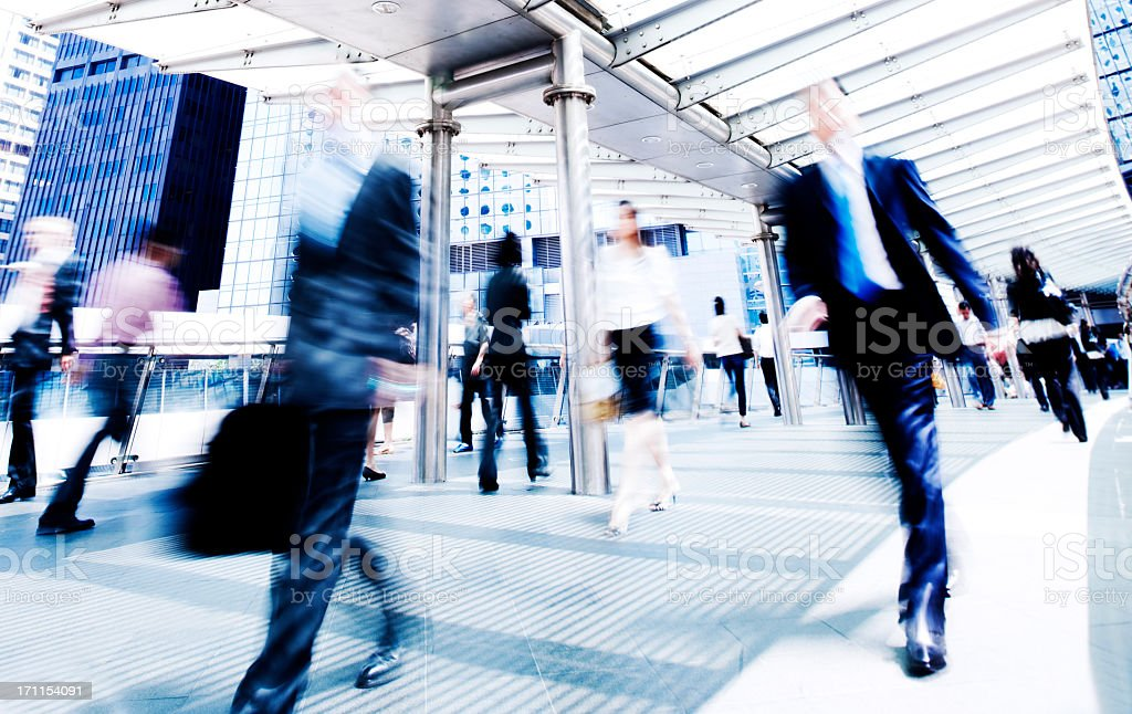 Business people in accelerated motion stock photo