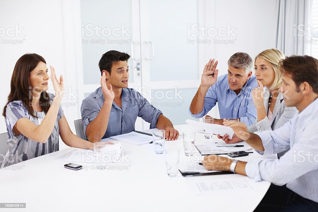 Business people in agreement during a meeting stock photo