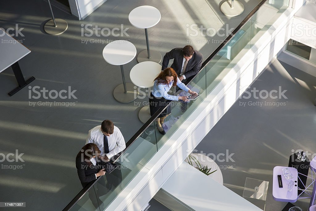 Business people in an entrance hall of office building royalty-free stock photo