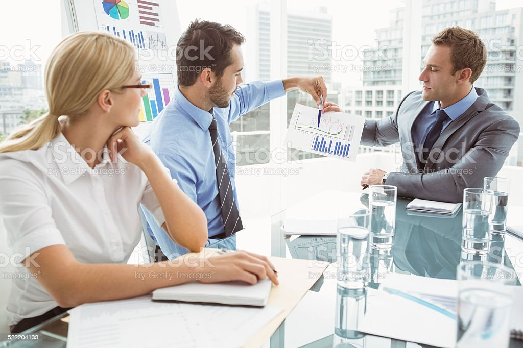Business people in board room meeting stock photo
