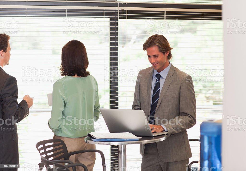 Business people in break room royalty-free stock photo