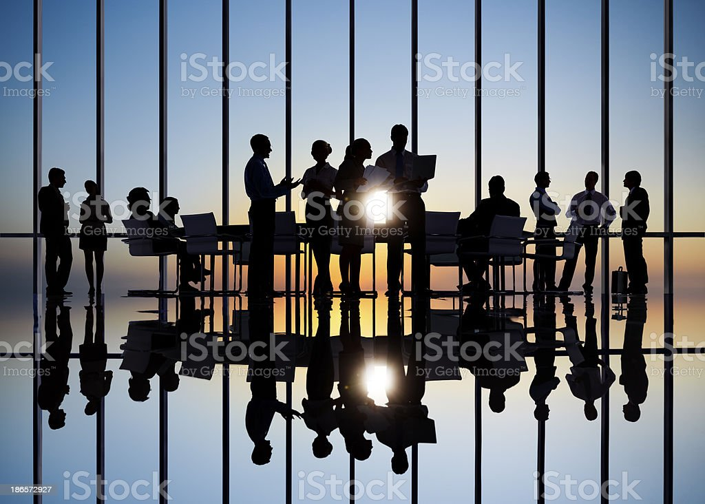 Business people in conference with associates royalty-free stock photo