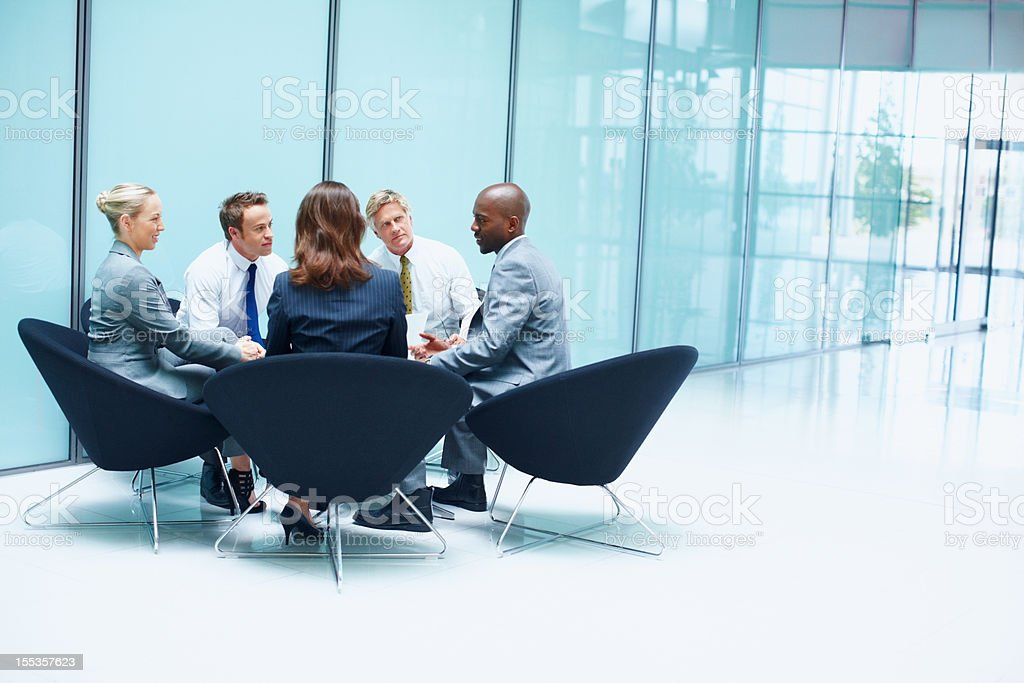 Business people in constructive discussion royalty-free stock photo