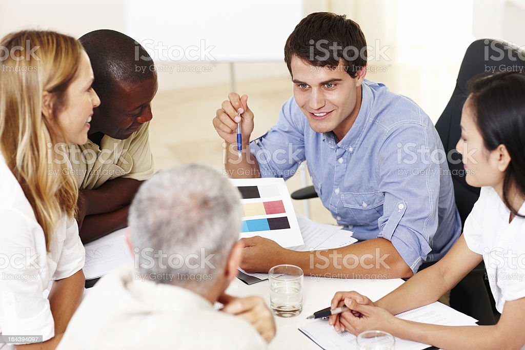 Business people in discussion about color samples royalty-free stock photo