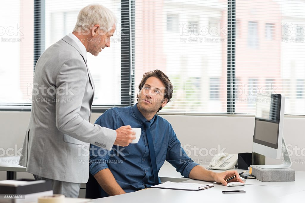 Business people in discussion stock photo