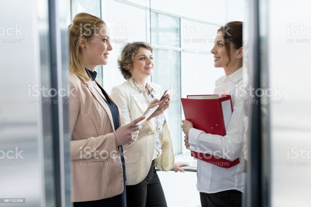 Business people in elevator stock photo
