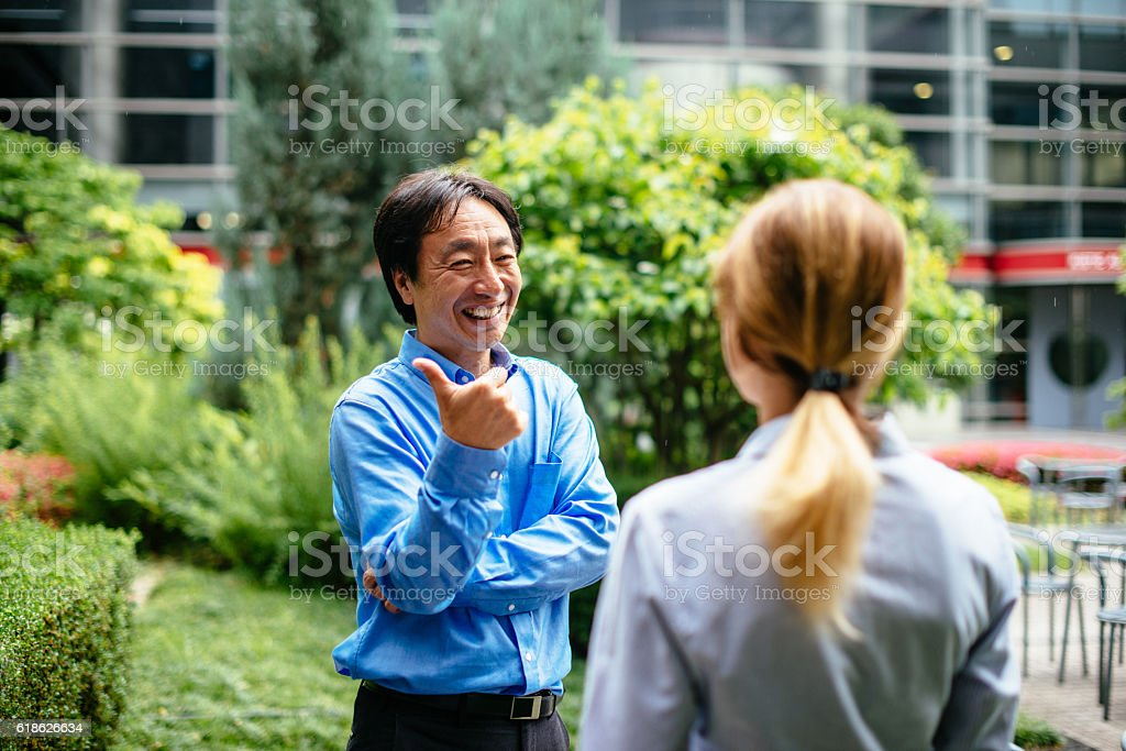 Business people in Japan, talking and smiling stock photo