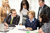 Business People In Meeting At Office Table