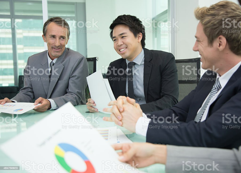 Business people in meeting room stock photo