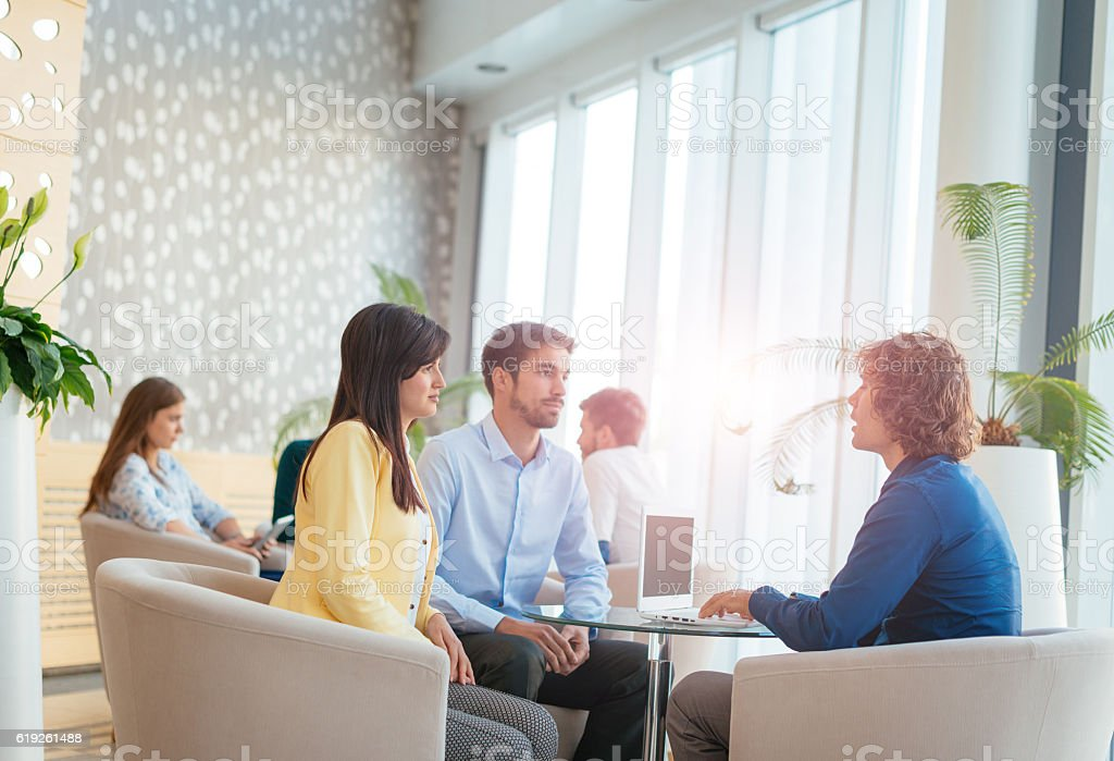 Business people in modern hotel interior stock photo