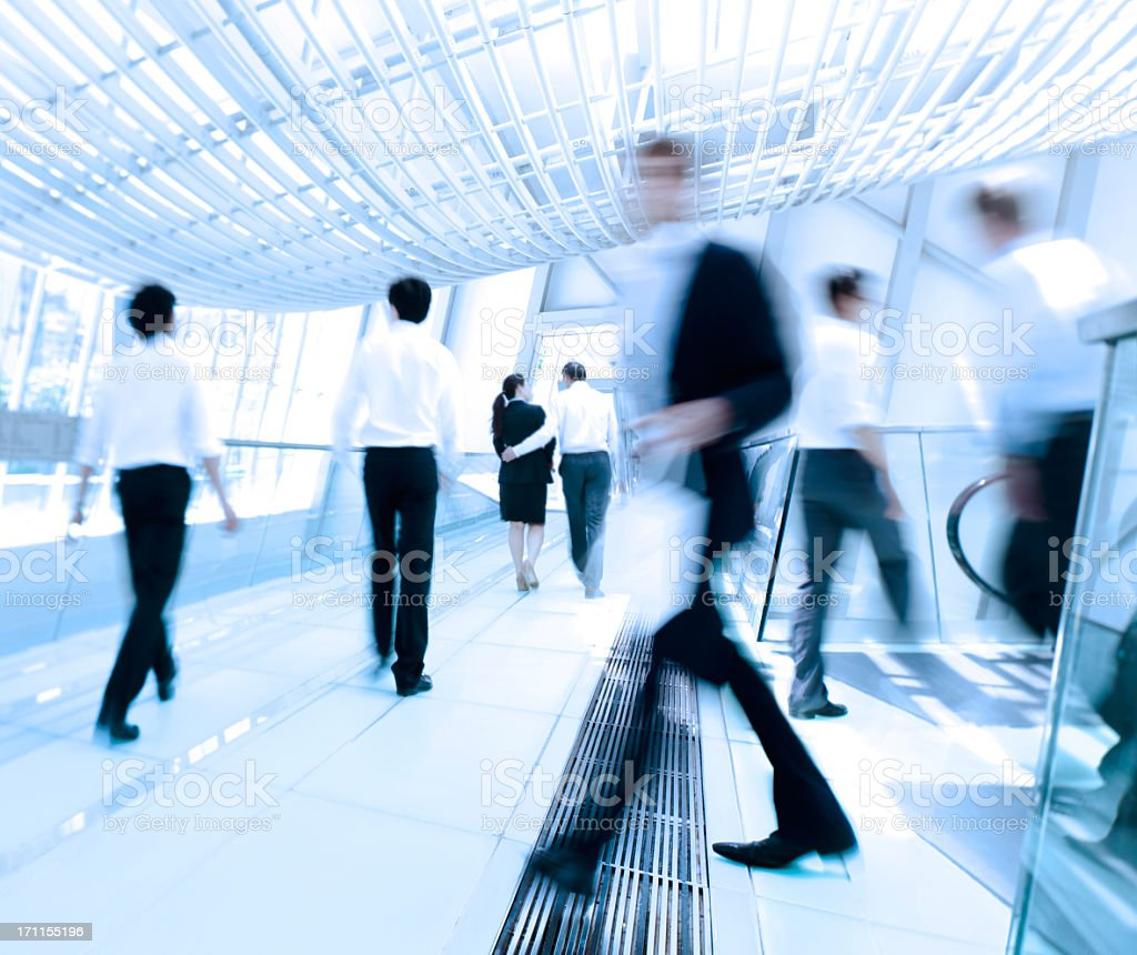 Business people in motion at work stock photo