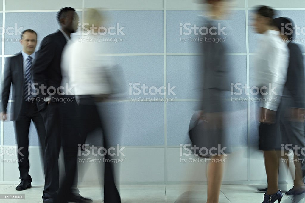 Business people in motion royalty-free stock photo