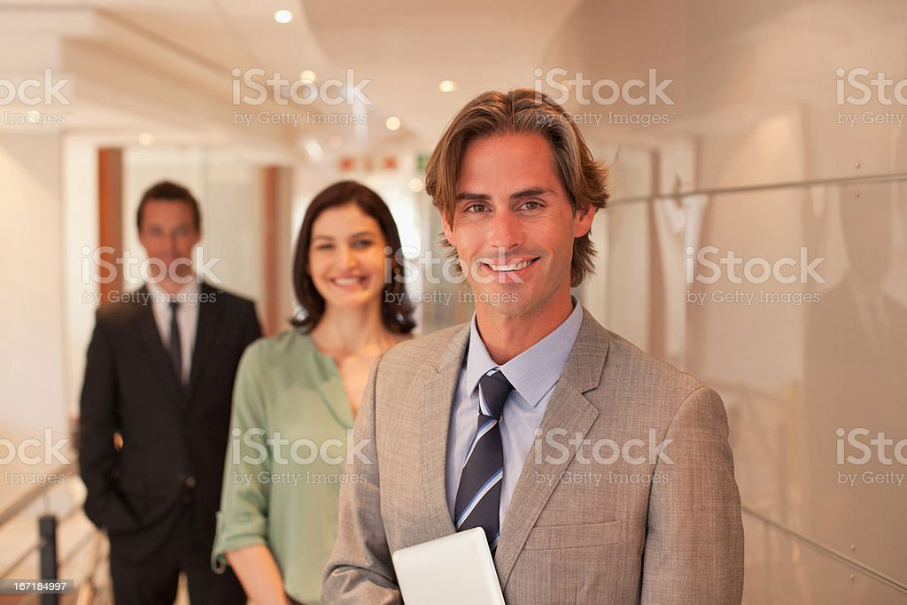 Business people in office corridor royalty-free stock photo