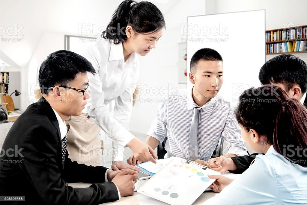 Business people in office meeting to discuss stock photo